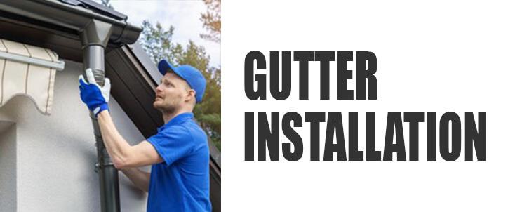 Gutter Installation man installing gutter