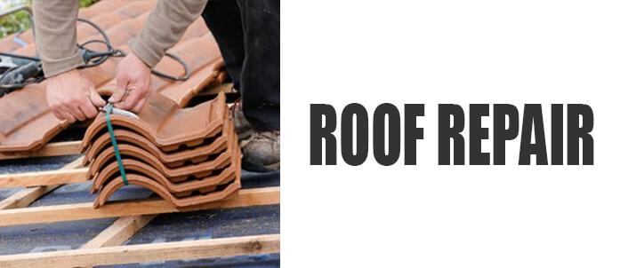 Roof Repair man repairing roof