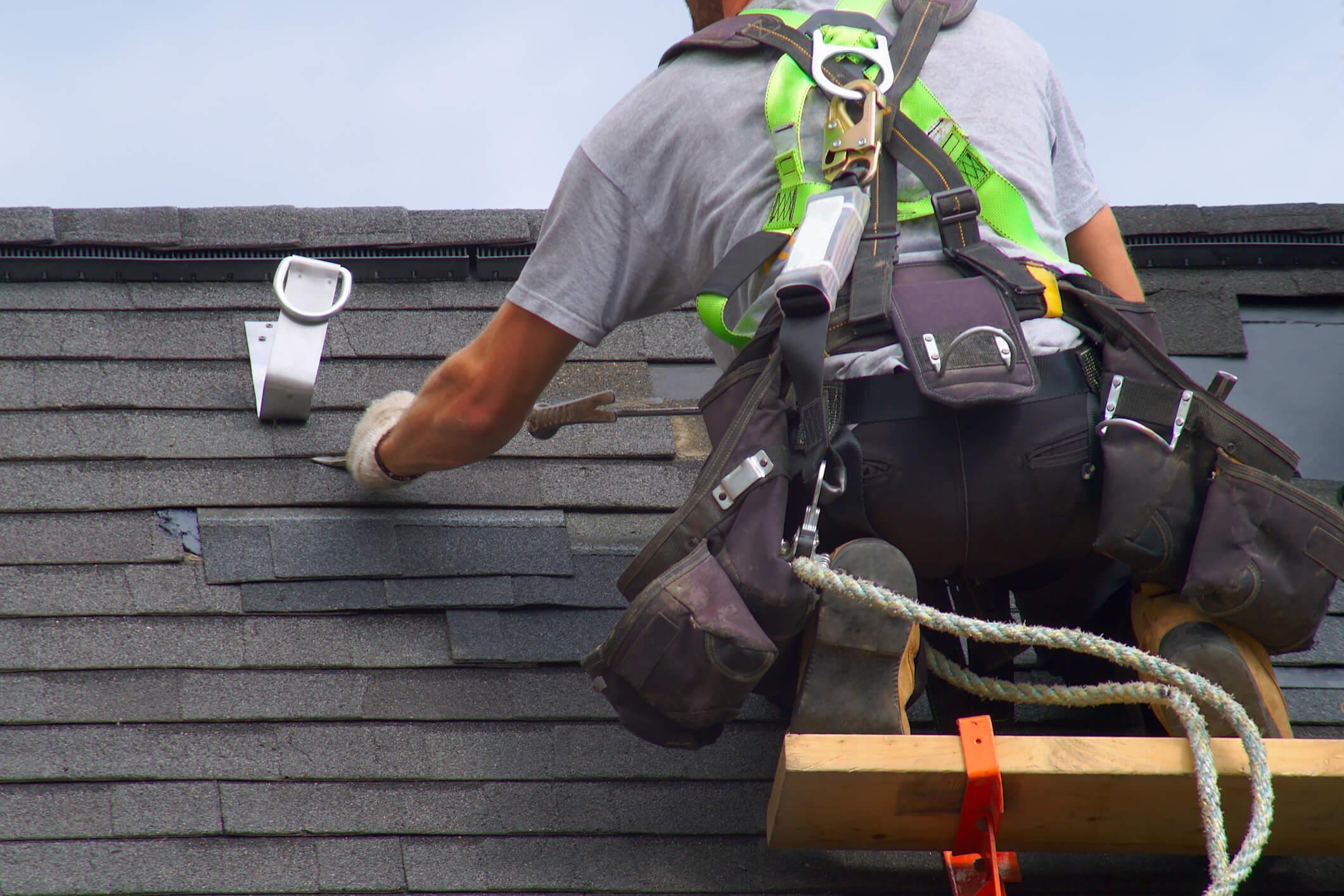 roof repair construction worker