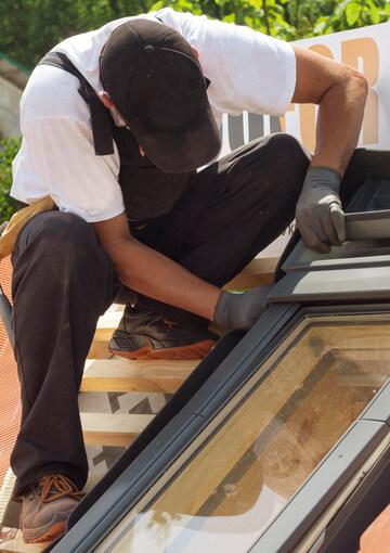 roofer installing window