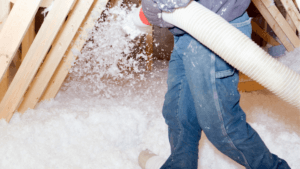 Roofing Contractor In Attic Spraying Foam Insulation (1)